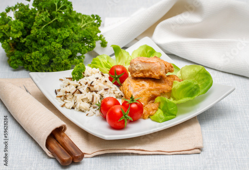 Grilled salmon fillet with rice and vegetables