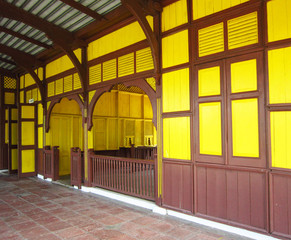 Old railway station painted yellow color and brown color on wood