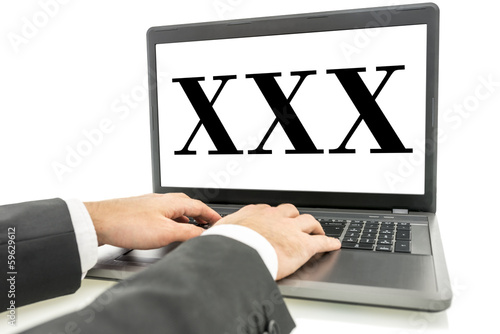 XXX written on laptop monitor