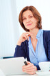 40s woman with pad in office