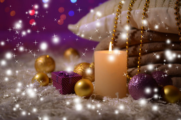 Composition with plaids, candles and Christmas decorations,