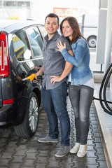 Young Couple at Gas Station