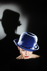 Elegant senior woman in hat