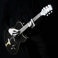 Electric Guitar Guitarist player on black