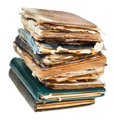 stack of old books with pages torn out