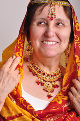 senior woman in traditional Indian clothing and jeweleries