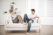 cheerful couple reading books on couch