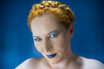red-haired woman with blue lips