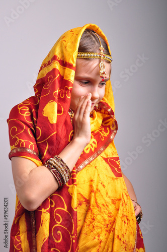 little girl in traditional Indian clothing dancing