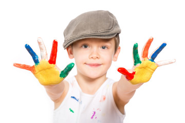 boy with hands in paint on white