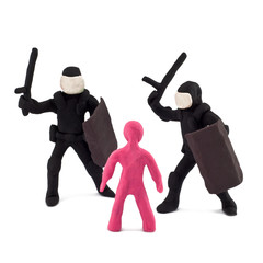 Plasticine police beating children