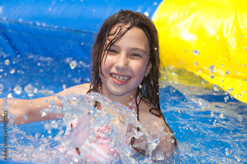 happy girl in swimming pool
