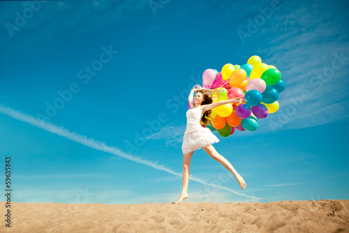 Beauty young stylish woman with multi-colored rainbow balloons i