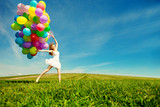 Fototapety Happy birthday woman against the sky with rainbow-colored air ba