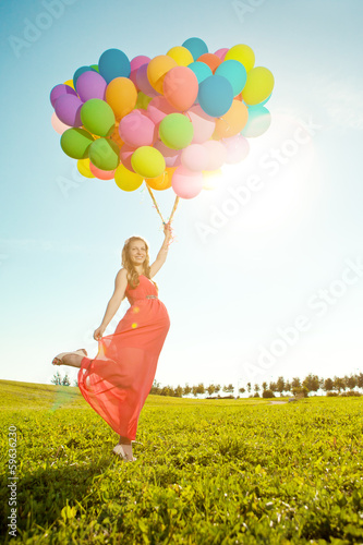 Young healthy beauty pregnant woman with balloons  outdoors. A g