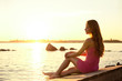 Beauty woman on the beach at sunset. Enjoy nature. Luxury girl r