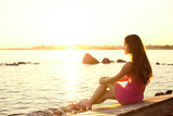 Fototapety Beauty woman on the beach at sunset. Enjoy nature. Luxury girl r