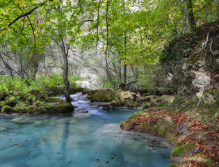 Autumn landscape with turquoise water.Northern Spain.