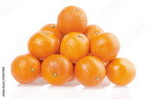 pile of tangerines on a white background
