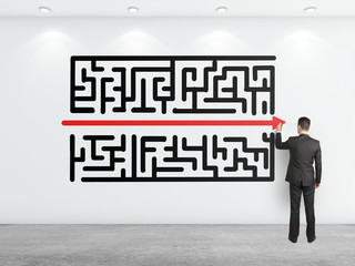 businessman drawing maze