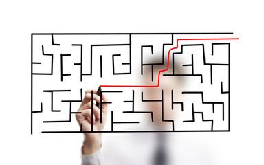 businessman drawing labyrinth