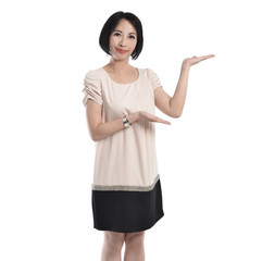 Woman in business attire posing with an open palm