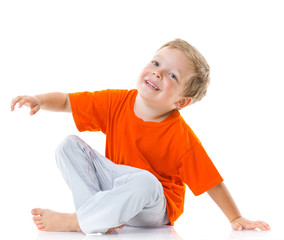 Happy boy sitting on the floor