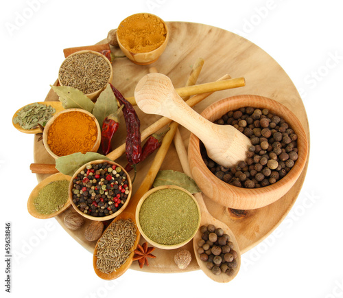 Fotobehang Kruiden wooden mortar, bowls and spoons with spices isolated on white