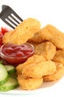 Fried chicken nuggets with sauce and vegetables isolated