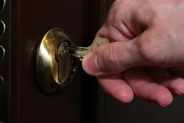 Someone opens door key close-up