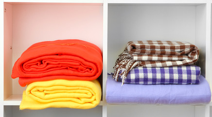Bright plaids on shelves, isolated on white