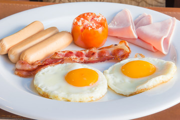 Traditional breakfast eggs with ham