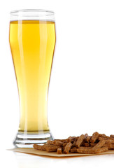 Beer in glass and croutons isolated on white
