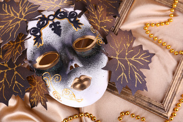 Mask on golden fabric background