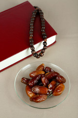 Composition with holy book,rosary and dates palm,