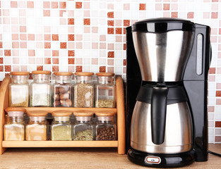Coffee maker in kitchen on table on mosaic tiles background