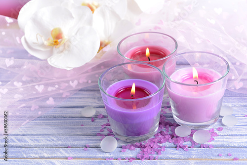 Beautiful colorful candles and  orchid flowers,