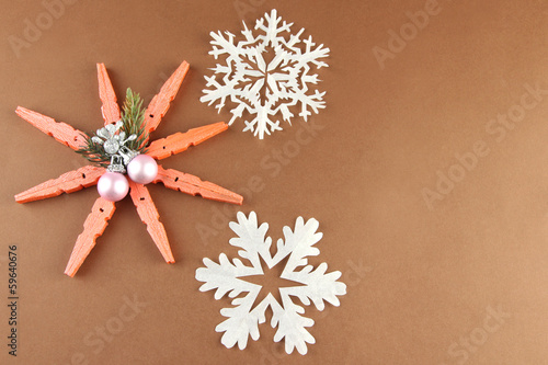 Beautiful snowflakes on brown background