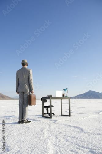Businessman Arriving at Mobile Office Desk Outdoors