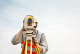 Surveyor engineer making measure with cloud background