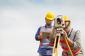 Surveyor engineer making measure with tablet pc