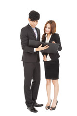 Business people standing and  reading  document together