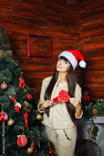 Girl with lollipop and Christmas tree
