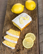 Sliced lemon pound cake with white icing