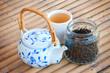 Asian tea drink and vintage tea pot.