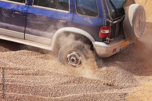 racer stuck in the sands of the desert