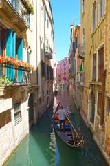 narrow canals with gondolas Venice, Italy, Europe.
