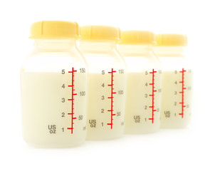 Row of milk bottle front focus on white background.