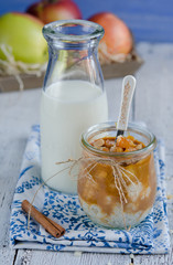Milk-rice dessert with caramelized apples in glass jar