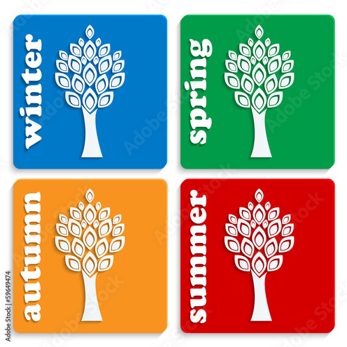 set of icons symbolizing seasons.white trees on colorful squares